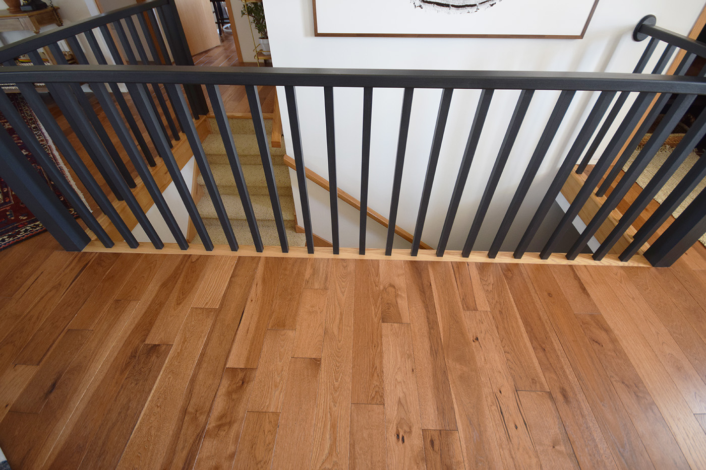 Hardwood Flooring Installation After stair banister transition