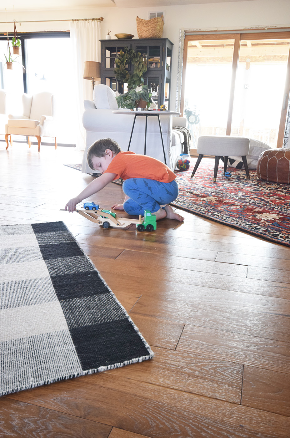 Hardwood Flooring Installation After son playing with trucks