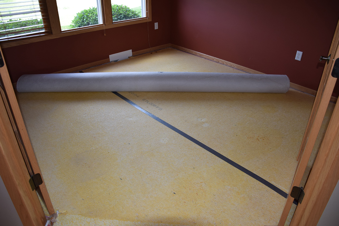 Carpet removed for Hardwood Flooring installation dining room