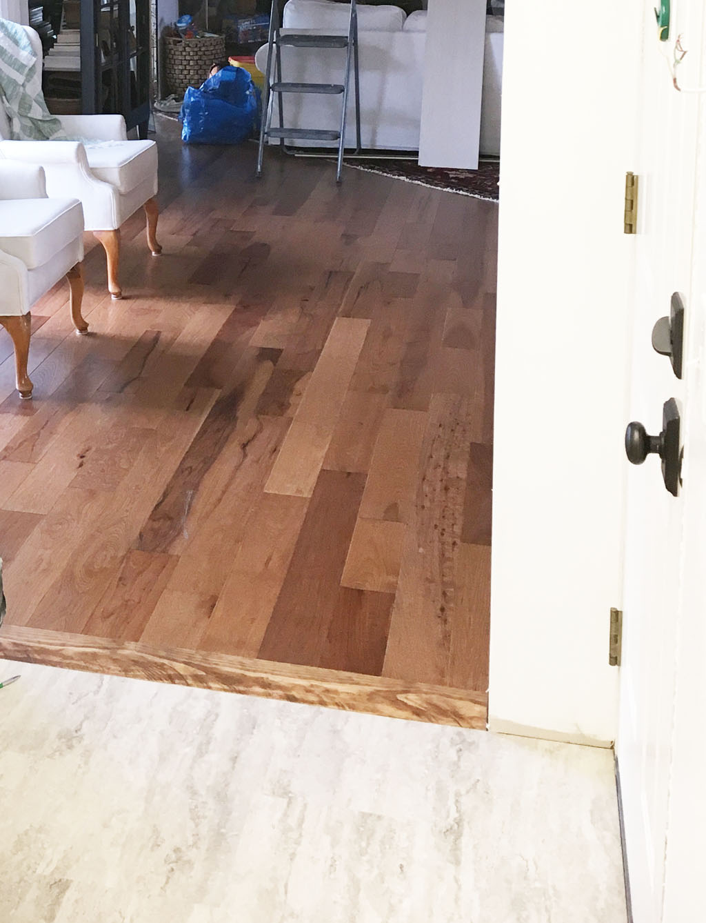 Mudroom tile to hardwood flooring transition